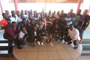 Group picture of Mr. Herbert Mensah,Rugby Players, Executives of GRFU and  rugby coached