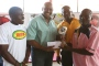Mr. Herbert Mensah presents trophy to the Captain of Salim 7 as GRUPA executives offer support